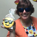 image of Dr. Deb New with emoji cookie